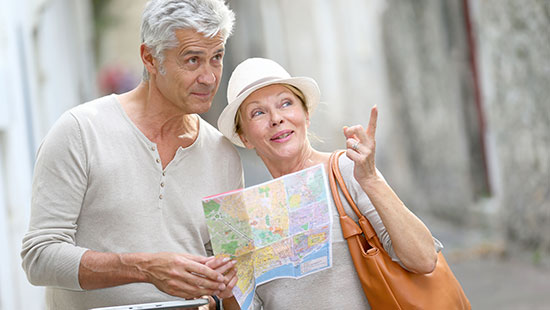 TouristsMapSeniorCouple