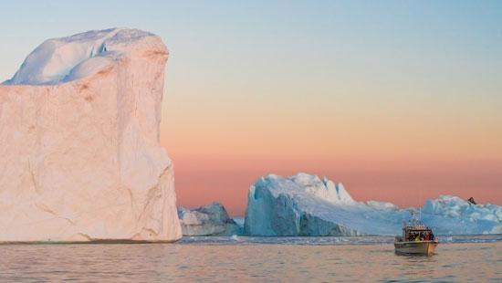 Ilulissat icebergs in midnight sun