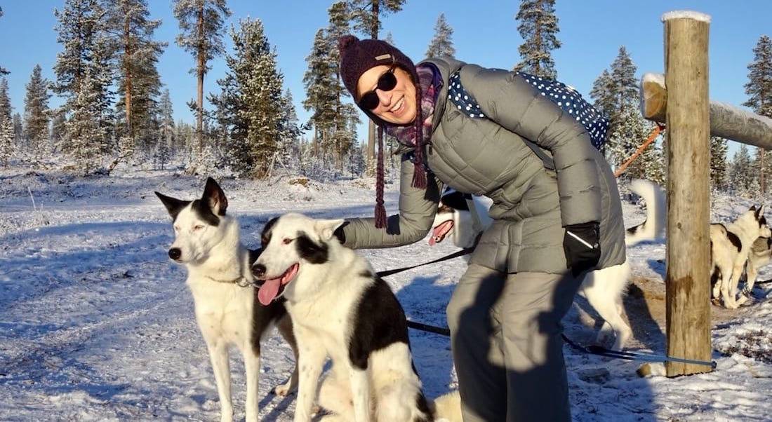 Judy with dogs in Finland